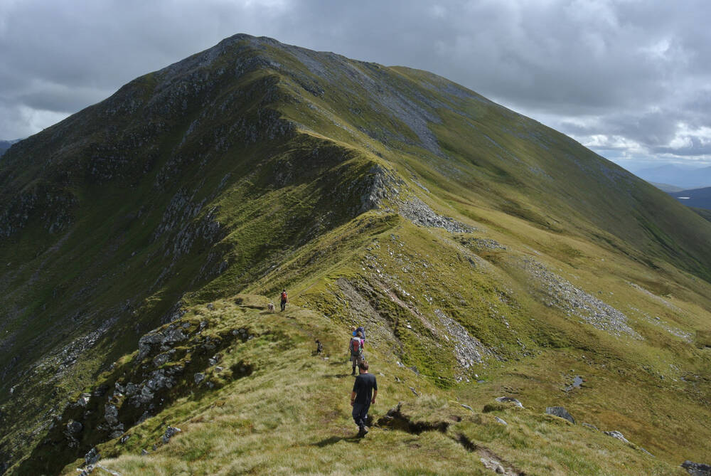 Hikers on a ridge walk at Kintail