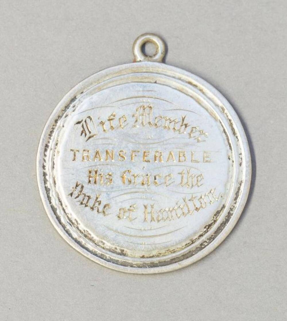A silver-coloured medal, inscribed with 'Life Member, Transferable, His Grace the Duke of Hamilton'.