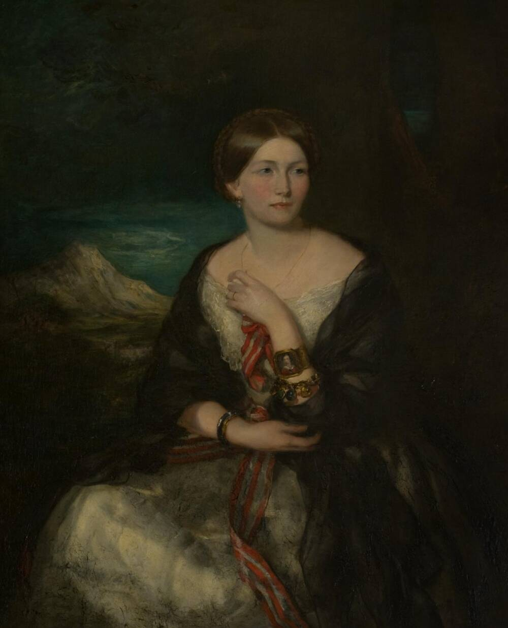 Portrait of a woman wearing a light coloured dress with a dark shawl.