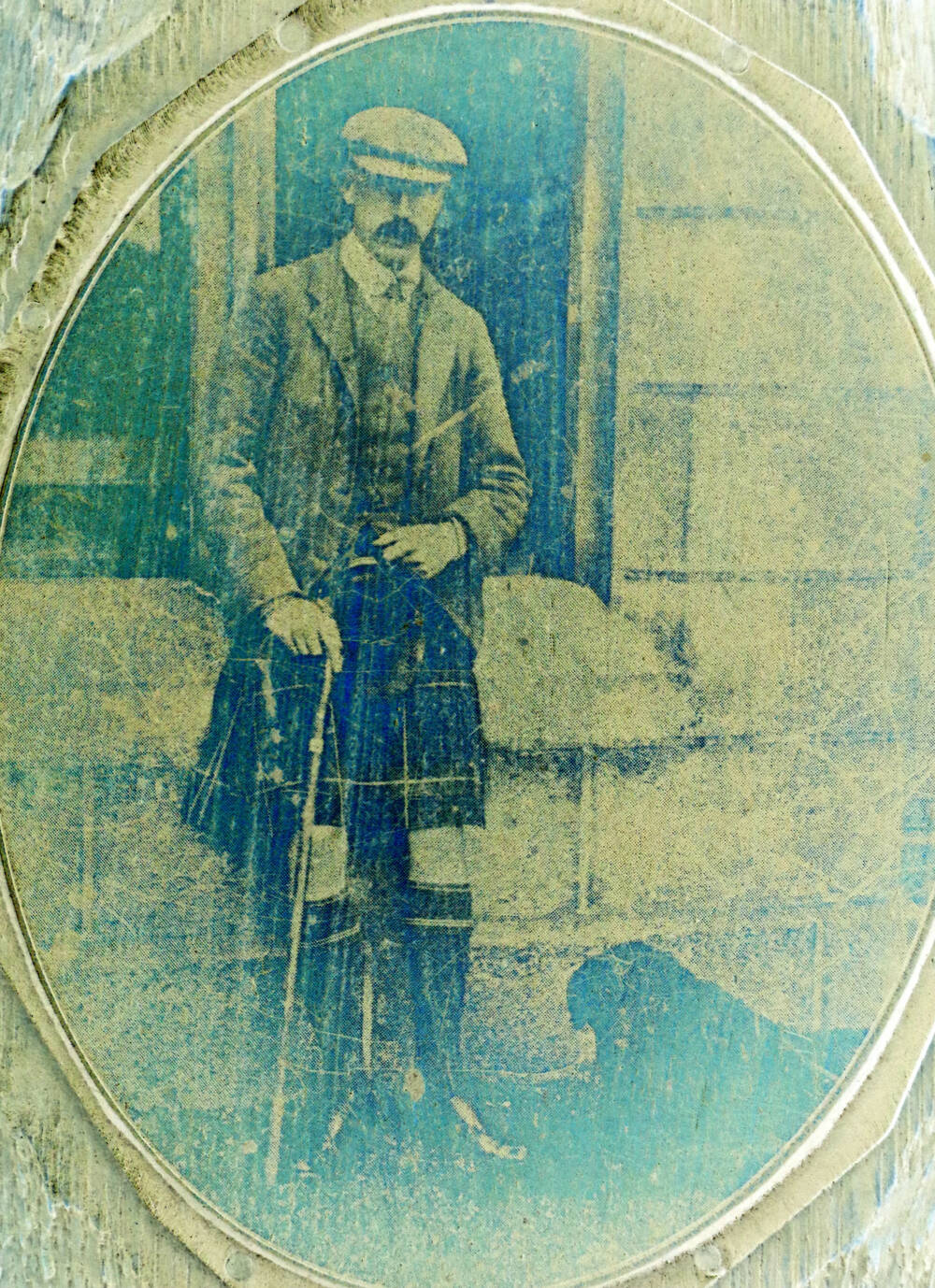 The positive image of a kilted man, holding a walking stick