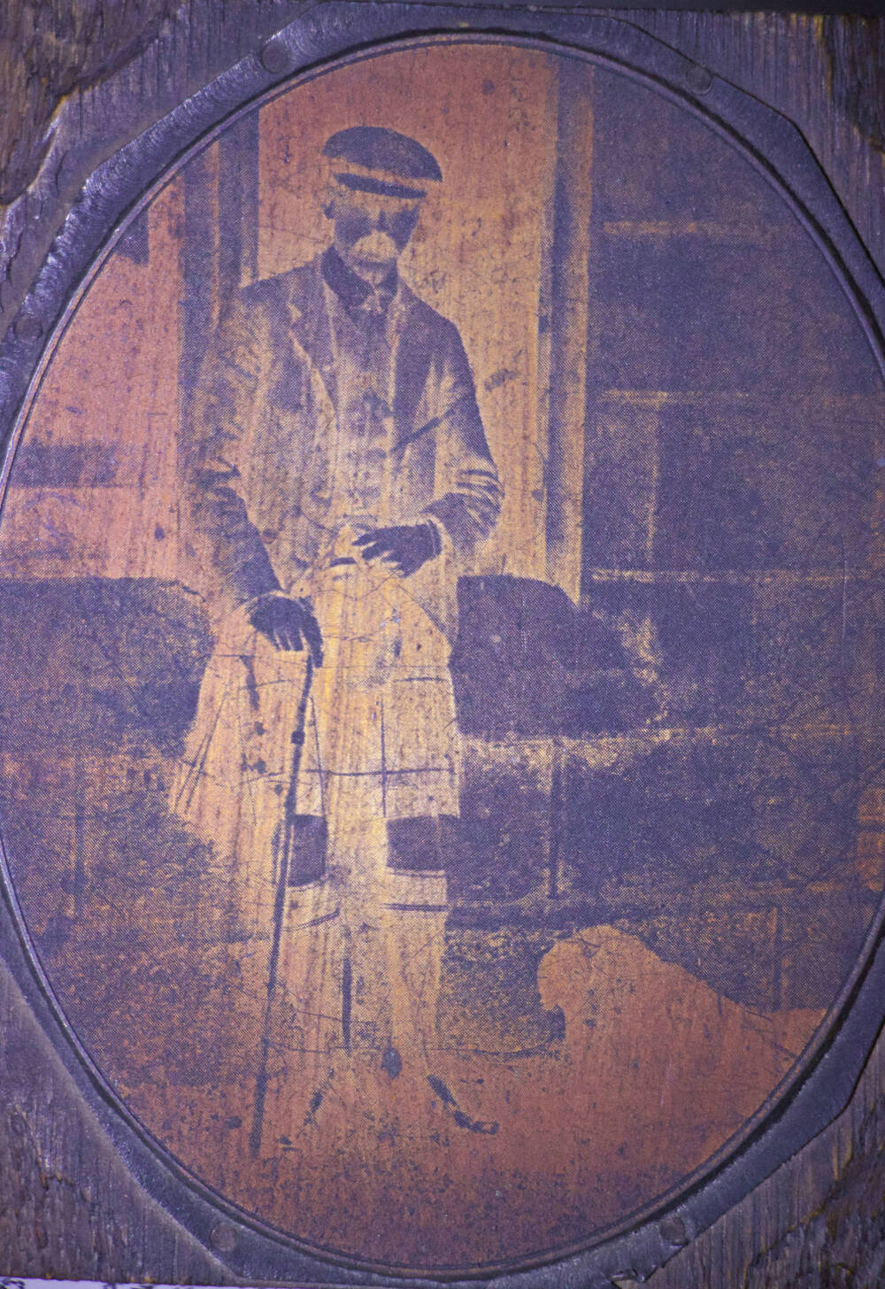 Negative image of a kilted man, holding a walking stick