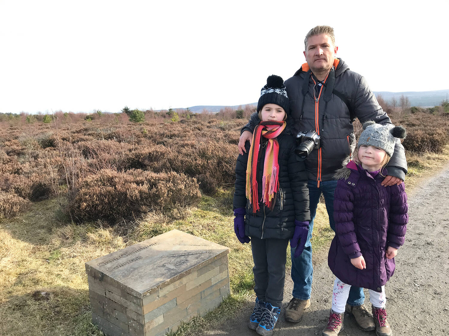 Travel writer Robin McKelvie with his two daughters at Culloden
