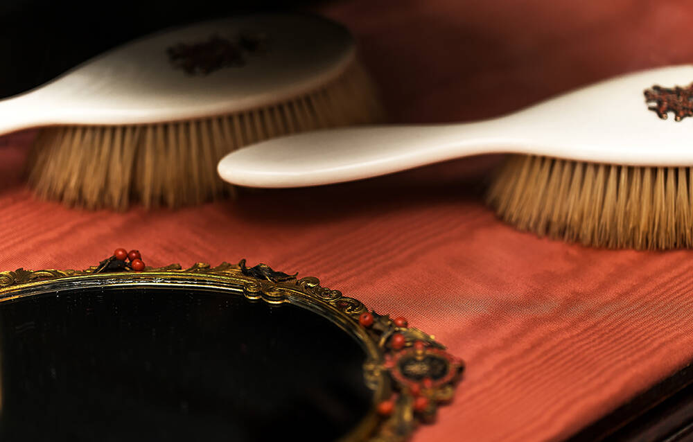 Fine horse hair and enamel brushes were used for brushing hair and brushing down soiled clothes.