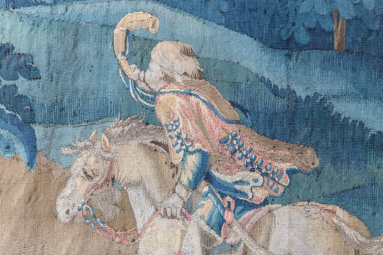 Detail of a hunter on horseback before cleaning
