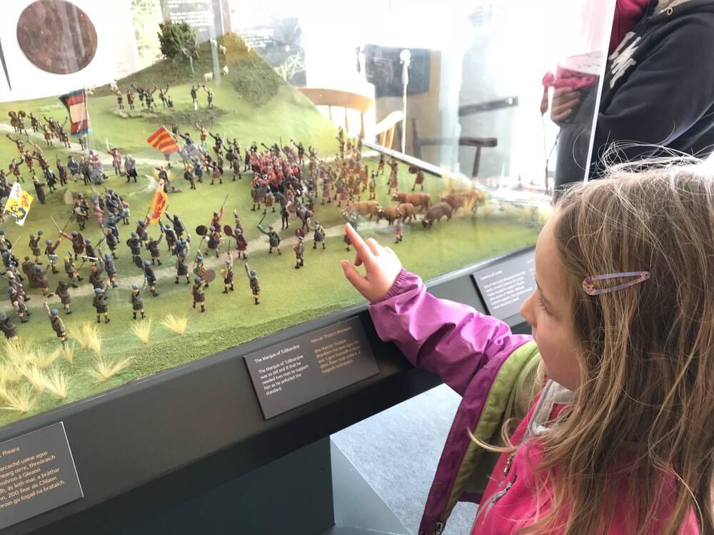 Emma checks out the model display