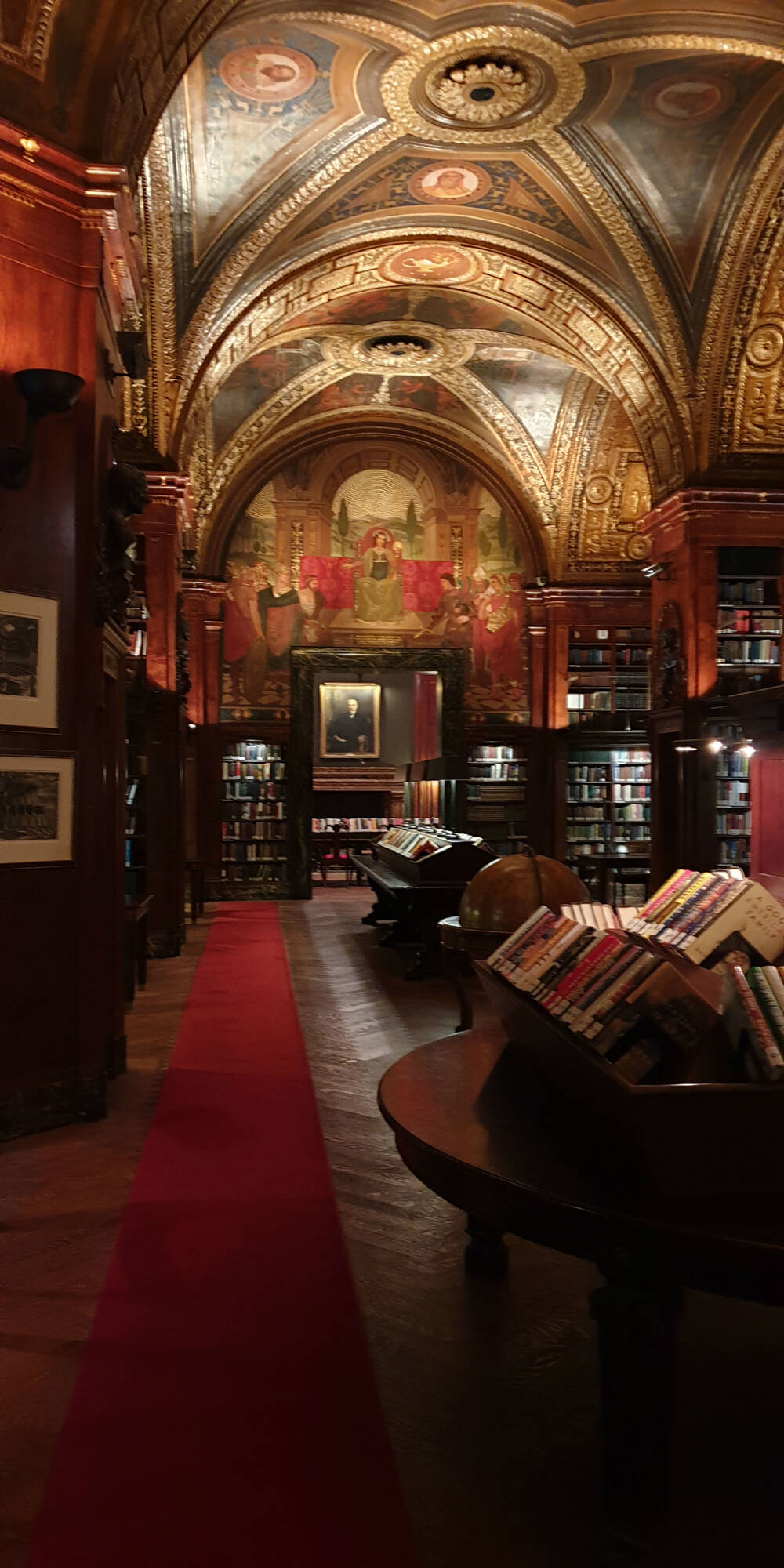 A grand library room with a vaulted painted ceiling in New York