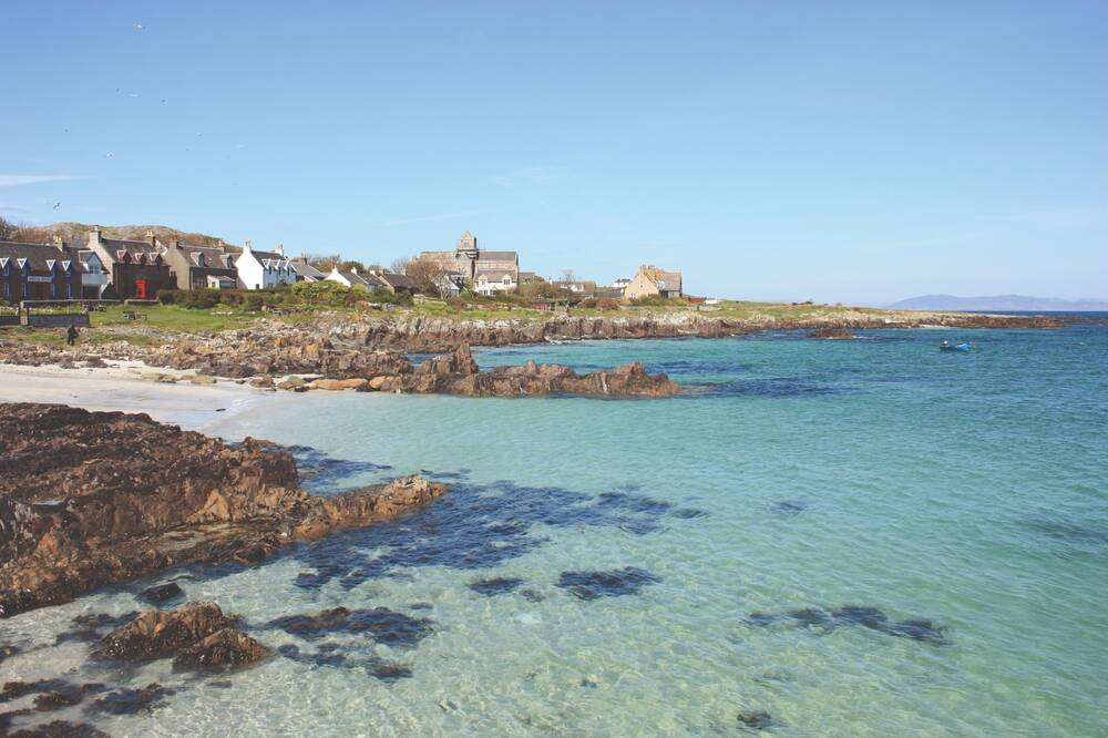 The seashore at Iona, with the abbey in the distance.