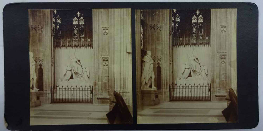 A black and white stereo image of 2 almost identical views of a chapel interior and a stone memorial of a woman and 2 angels.