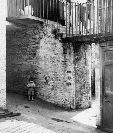 Boy standing in front of a wall