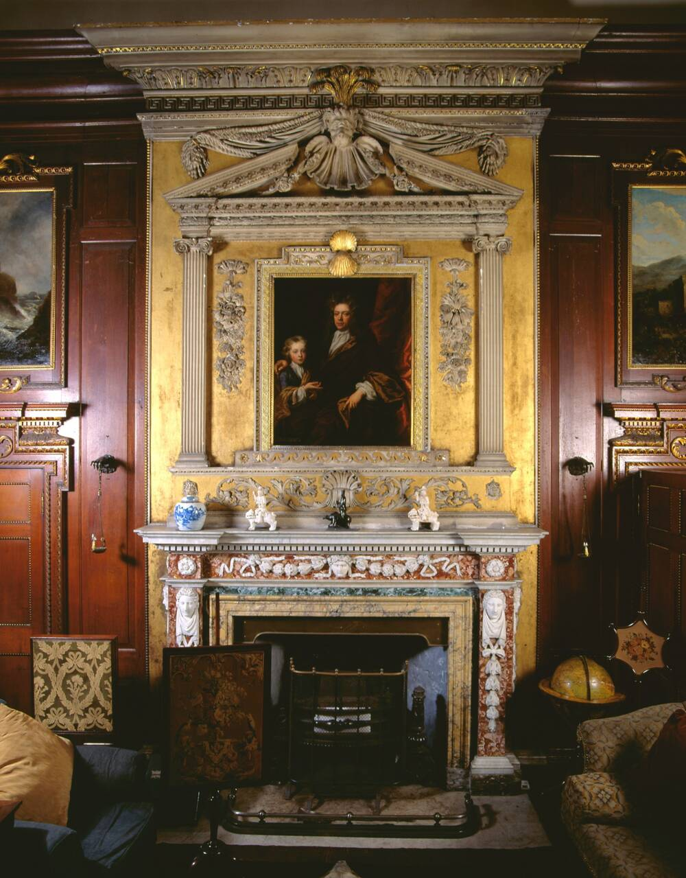 Newhailes library - the chimneypiece was installed in the 1740s by Sir James Dalyrmple (seen in the portrait)