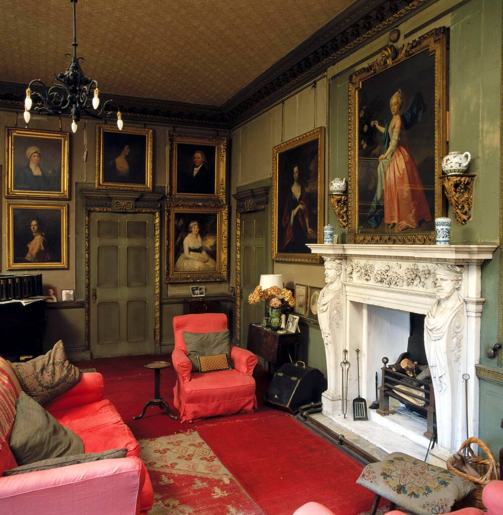The chintz room is now known as the winter sitting room; in Miss Christian's day this room was decorated with 18th-century Chinese wallpaper.