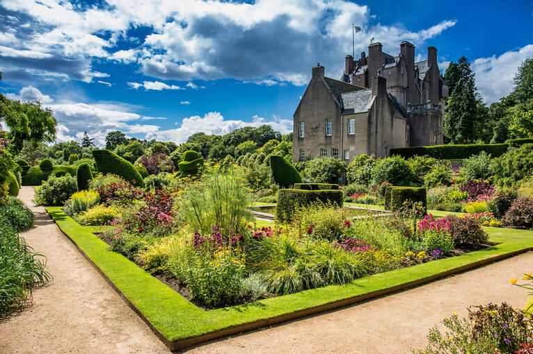 Crathes Castle is a 16th-century tower house with an intricate maze of turrets, towers, oak panels & painted ceilings.