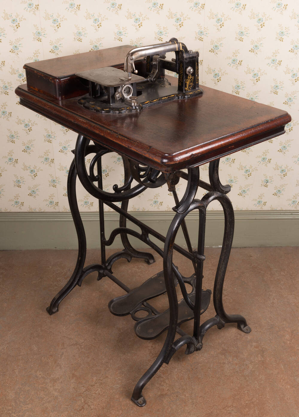 An 1860s Wheeler & Wilson double-thread lock-stitch sewing machine with metal treadle sandals.