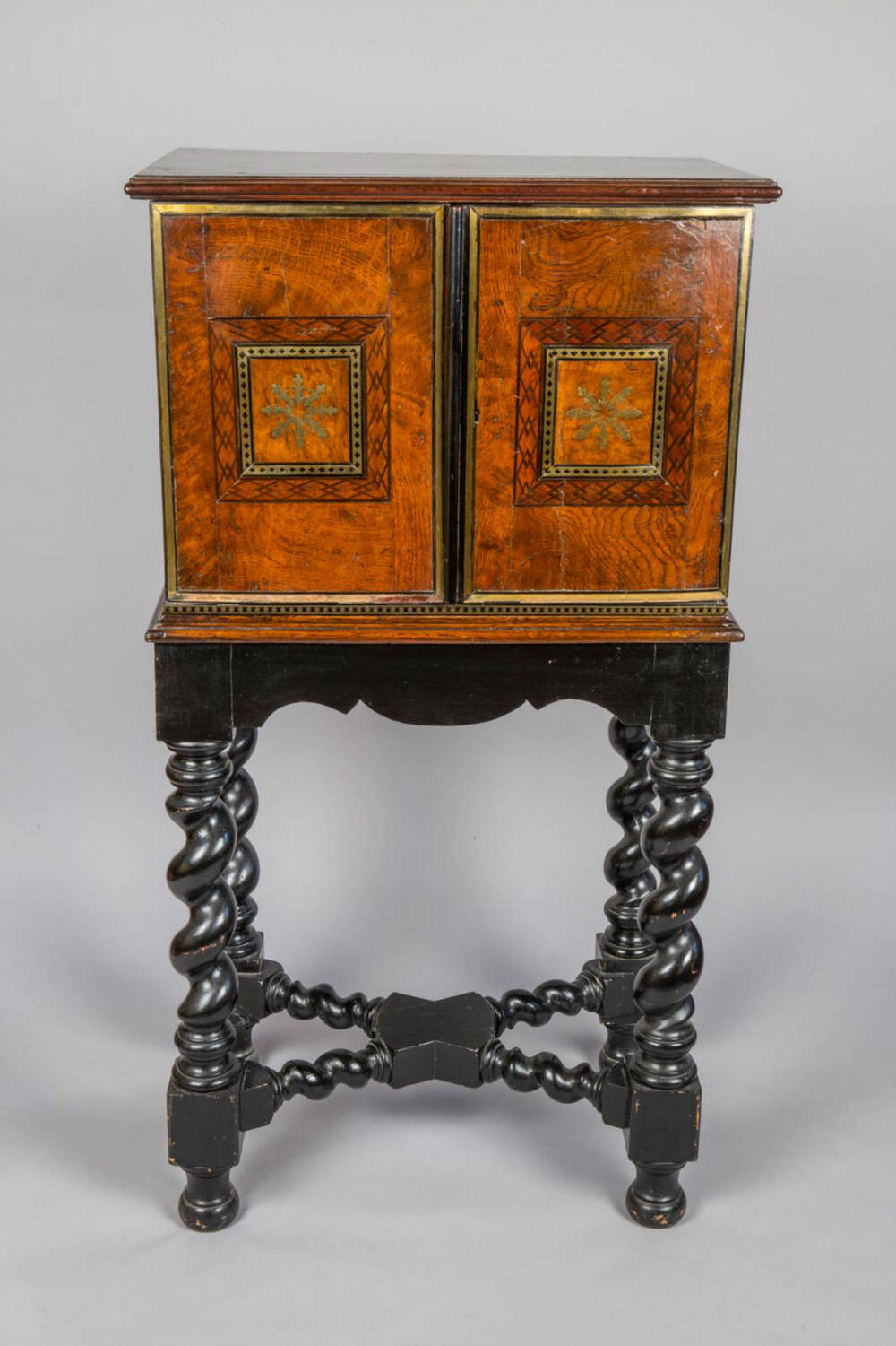 A 17th-century spice cabinet from Crathes Castle, sitting on a later stand