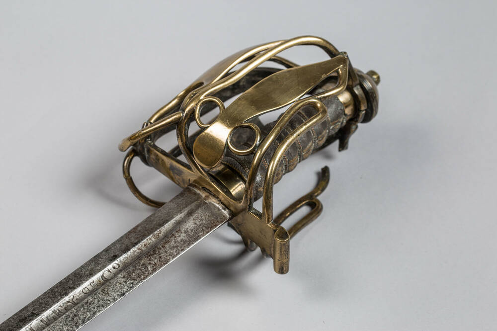 The brass basket-hilt of the Scottish regimental 'Waterloo' sword