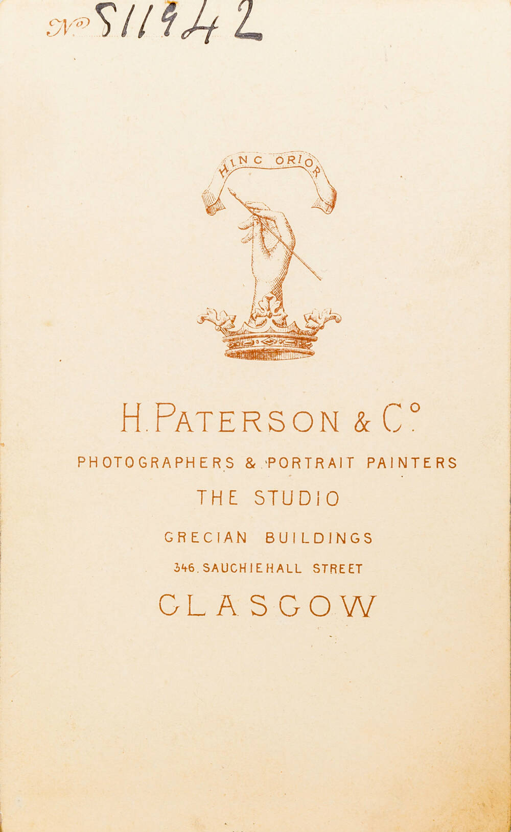 The back of a photo printed with 'H. Paterson & Co.' and their logo of a hand rising from a crown holding a paintbrush.
