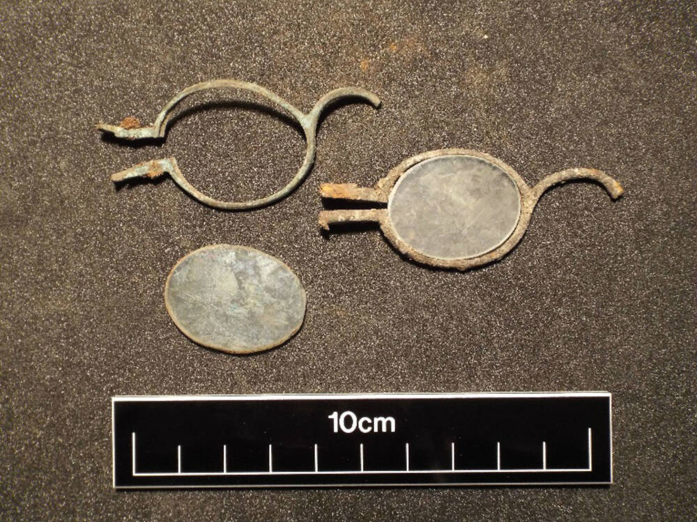Fragments of reading glasses found at Weaver's Cottage
