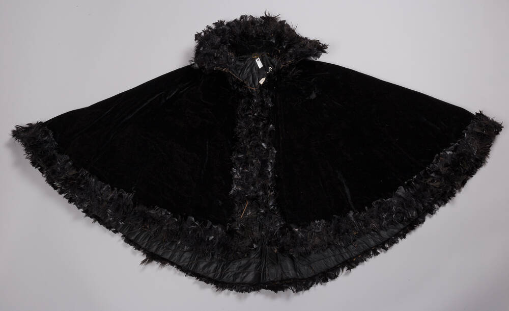Black velvet Victorian mourning cape, with black feather trim (Weaver's Cottage)