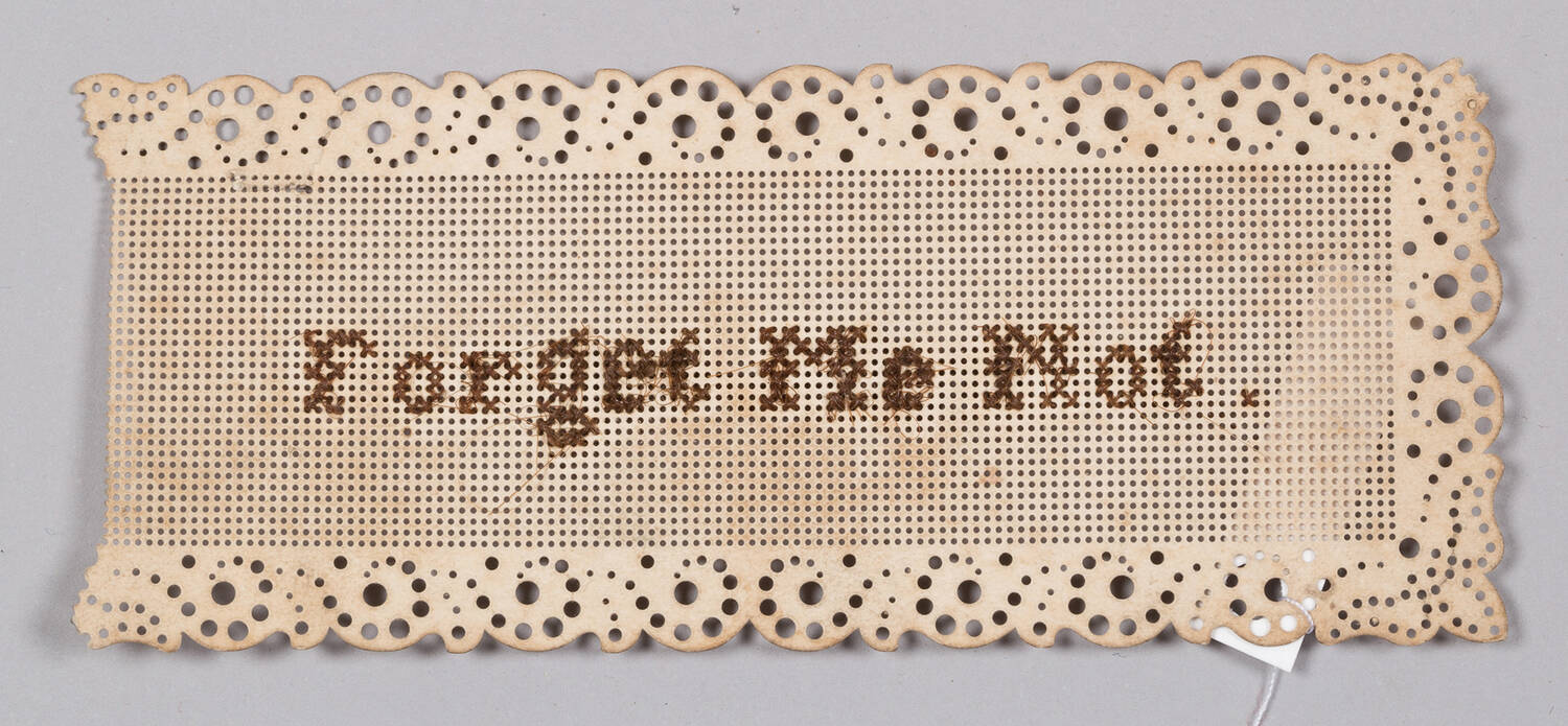 Paper embroidered with 'Forget Me Not' in human hair (Weaver's Cottage)